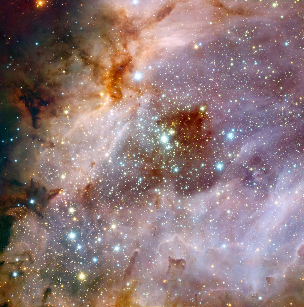 omega nebula stars,stellar nursery
